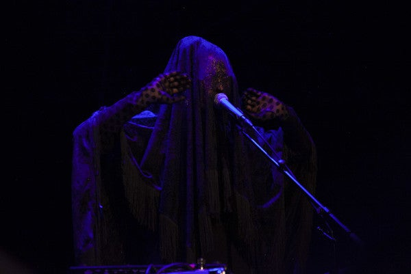 Sley performs in veil at IN